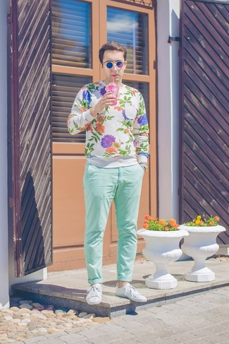 How to wear: blue sunglasses, white leather low top sneakers, mint chinos, white floral crew-neck sweater