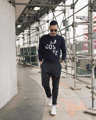 How to wear: black sunglasses, white low top sneakers, black chinos, navy and white print crew-neck sweater