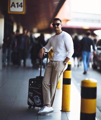 How to wear: black sunglasses, white leather low top sneakers, beige chinos, white crew-neck sweater