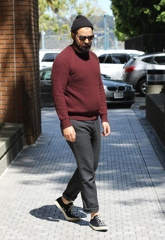 How to Wear Black and White Canvas Low Top Sneakers For Men: If you're looking for a casual but also dapper getup, pair a burgundy crew-neck sweater with charcoal chinos. Our favorite of an infinite number of ways to complement this look is with black and white canvas low top sneakers.
