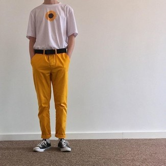 How to wear: black canvas belt, black and white canvas low top sneakers, mustard chinos, white floral crew-neck t-shirt