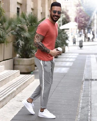 How to wear: grey sunglasses, white leather low top sneakers, grey chinos, red crew-neck t-shirt