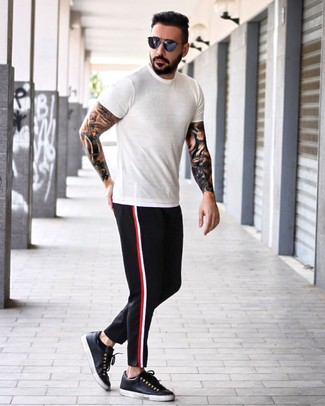 How to wear: navy sunglasses, black leather low top sneakers, black chinos, white crew-neck t-shirt