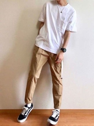 How to Wear Black and White Canvas Low Top Sneakers For Men: Wear a white crew-neck t-shirt with khaki chinos for a seriously stylish, casual outfit. Black and white canvas low top sneakers integrate really well within a ton of outfits.