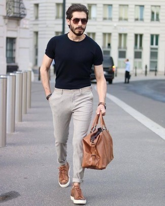 How to Wear Tobacco Leather Low Top Sneakers For Men: For comfort dressing with a clear fashion twist, make a black crew-neck t-shirt and beige chinos your outfit choice. Let your styling chops truly shine by complementing your getup with tobacco leather low top sneakers.