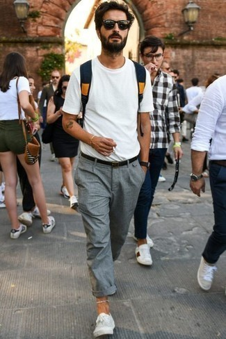 How to Wear a Black Leather Belt For Men: If it's comfort and functionality that you're searching for in an ensemble, make a white crew-neck t-shirt and a black leather belt your outfit choice. Let's make a bit more effort with shoes and complete this ensemble with a pair of white canvas low top sneakers.