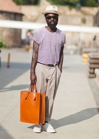 How to Wear a Beige Straw Hat For Men: For an on-trend ensemble without the need to sacrifice on comfort, we turn to this combo of a white and red horizontal striped crew-neck t-shirt and a beige straw hat. A pair of white leather low top sneakers will add a refined aesthetic to the look.