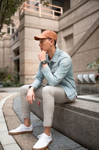 How to wear: orange baseball cap, white leather low top sneakers, beige chinos, light blue denim jacket