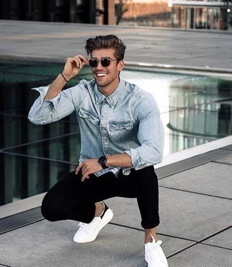 How to Wear Burgundy Sunglasses For Men: If you like comfortable menswear, pair a light blue denim shirt with burgundy sunglasses. Channel your inner David Beckham and add white and black canvas low top sneakers to the mix.