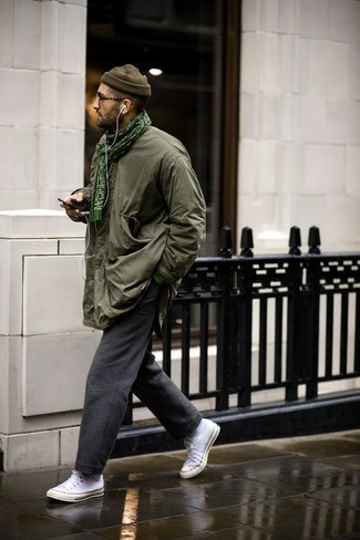 How to Wear Charcoal Wool Chinos: An olive field jacket and charcoal wool chinos are a good outfit formula to keep in your menswear arsenal. If you want to break out of the mold a little, complement your outfit with a pair of white canvas low top sneakers.