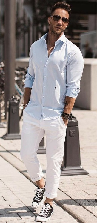 How to wear: dark brown sunglasses, black and white canvas low top sneakers, white chinos, light blue long sleeve shirt