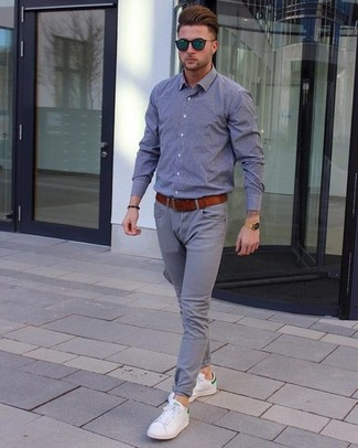 How to wear: tobacco leather belt, white leather low top sneakers, grey chinos, grey chambray long sleeve shirt