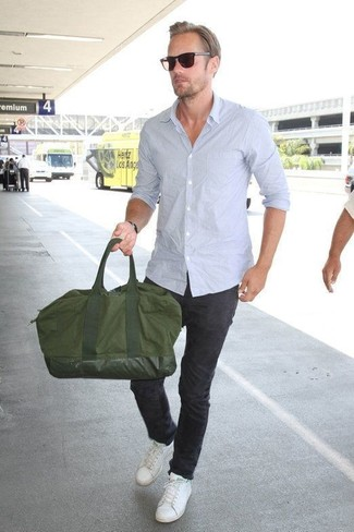 How to wear: olive canvas holdall, white leather low top sneakers, black chinos, light blue long sleeve shirt