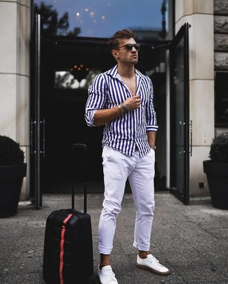 How to wear: black sunglasses, white leather low top sneakers, white chinos, white and navy vertical striped long sleeve shirt