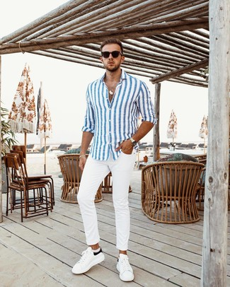 How to wear: black sunglasses, white and black leather low top sneakers, white chinos, white and blue vertical striped long sleeve shirt
