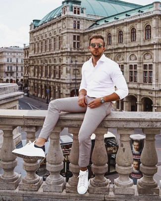 How to wear: gold sunglasses, white and black leather low top sneakers, white vertical striped chinos, white long sleeve shirt