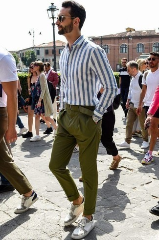 Men's Looks & Outfits: What To Wear In 2020: Make a white and blue vertical striped long sleeve shirt and olive chinos your outfit choice for a sharp, casual ensemble. Add white leather low top sneakers to the mix for extra style points.