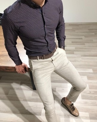 How to Wear a Navy Polka Dot Long Sleeve Shirt For Men: A navy polka dot long sleeve shirt and grey chinos are a nice look that will take you throughout the day and into the night. Let your outfit coordination chops truly shine by finishing off this look with beige suede low top sneakers.