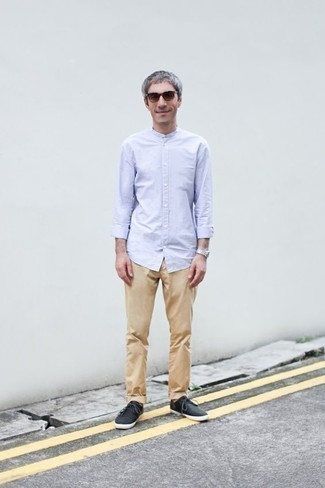 How to Wear Brown Sunglasses For Men: Consider pairing a light blue long sleeve shirt with brown sunglasses for a kick-ass and trendy ensemble. Black canvas low top sneakers will immediately polish off even the simplest look.