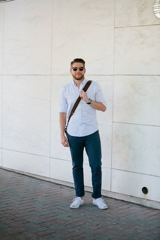 Men's Looks & Outfits: What To Wear Casually: A light blue long sleeve shirt and navy chinos are indispensable menswear items, without which our wardrobes would feel incomplete. For something more on the daring side to finish this outfit, complement this look with a pair of white canvas low top sneakers.