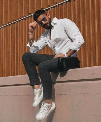 How To Wear a Long Sleeve Shirt With Chinos: This combination of a long sleeve shirt and chinos is hard proof that a pared down off-duty outfit doesn't have to be boring. And if you wish to easily dial down this look with one item, complement your outfit with white leather low top sneakers.