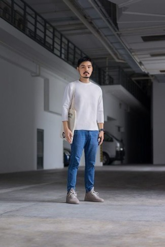 Men's Looks & Outfits: What To Wear In 2020: A white long sleeve t-shirt and blue chinos are a combo that every fashion-forward gent should have in his off-duty sartorial arsenal. As for shoes, add a pair of grey canvas low top sneakers to this outfit.