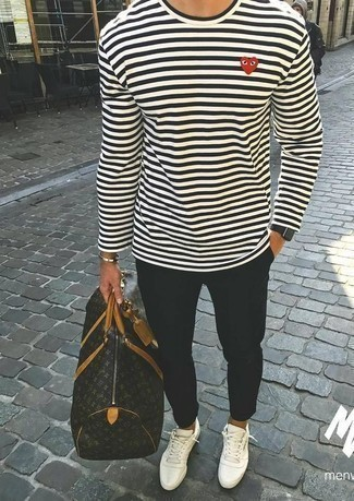 How to Wear White Canvas Low Top Sneakers For Men: Uber stylish and practical, this laid-back combination of a white and black horizontal striped long sleeve t-shirt and black chinos provides variety. Complete this look with white canvas low top sneakers and the whole getup will come together.