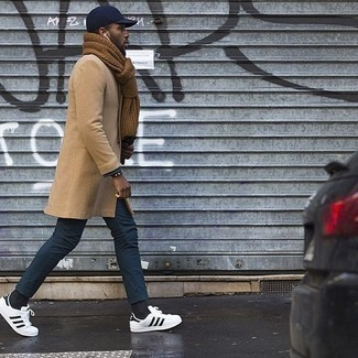 Men's Looks & Outfits: What To Wear In Fall: This combo of a camel overcoat and navy chinos looks considered and immediately makes any gentleman look sharp. Go off the beaten track and spice up your look by sporting a pair of white and black leather low top sneakers. When it's one of those bleak autumn days, sometimes only a knockout ensemble like this one can brighten it up.