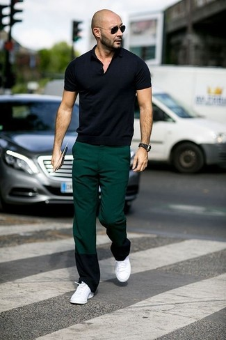 How to wear: black sunglasses, white low top sneakers, dark green chinos, black polo