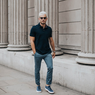 How to wear: black sunglasses, blue suede low top sneakers, blue chinos, black polo