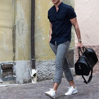 How to wear: black leather holdall, white leather low top sneakers, grey chinos, navy short sleeve shirt