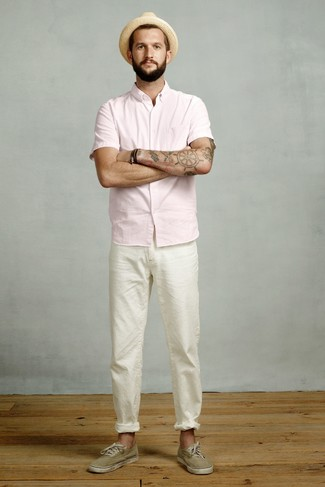 How to wear: tan straw hat, olive canvas low top sneakers, white chinos, pink short sleeve shirt