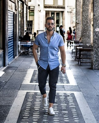 How to wear: grey sunglasses, white low top sneakers, navy vertical striped chinos, light blue short sleeve shirt