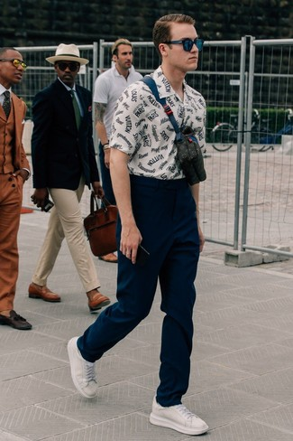 How to wear: black leather fanny pack, white leather low top sneakers, navy chinos, white and navy print short sleeve shirt