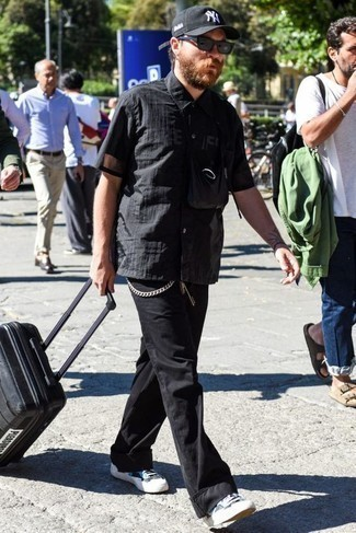 How to Wear a Black Suitcase For Men: Why not wear a black short sleeve shirt and a black suitcase? As well as very functional, these items look nice when worn together. Bump up the appeal of this ensemble by rocking a pair of black and white canvas low top sneakers. When it comes to casual dressing ideas for over-30 gentlemen, this ensemble looks great on most.