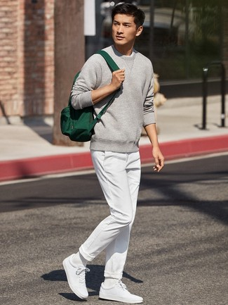 How to wear: dark green canvas backpack, white low top sneakers, white chinos, grey sweatshirt