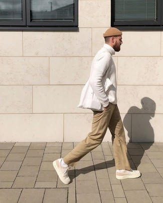 How to Wear a Tan Beanie For Men: A white wool turtleneck and a tan beanie are a good getup to have in your off-duty arsenal. You could perhaps get a little creative with footwear and add a pair of beige canvas low top sneakers to the equation.