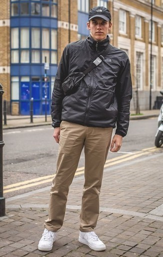 How to Wear a Black Leather Fanny Pack For Men: If you're searching for a relaxed casual but also on-trend outfit, marry a black windbreaker with a black leather fanny pack. And it's a wonder how a pair of white leather low top sneakers can class up an ensemble.