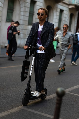 How to wear: black print canvas tote bag, white leather low top sneakers, white print crew-neck t-shirt, black vertical striped suit