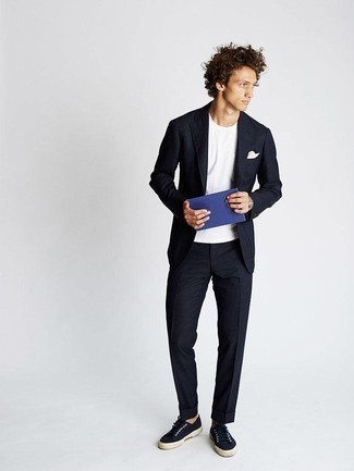 How to Wear Navy Canvas Low Top Sneakers For Men: When the setting calls for an effortlessly sleek ensemble, choose a navy suit and a white crew-neck t-shirt. Complete this outfit with a pair of navy canvas low top sneakers to make a sober outfit feel suddenly fresh.