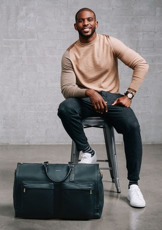 How to wear: black leather holdall, white leather low top sneakers, charcoal wool dress pants, tan crew-neck sweater
