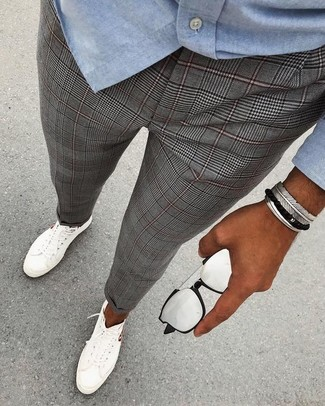How to wear: silver sunglasses, white low top sneakers, grey plaid dress pants, light blue chambray long sleeve shirt