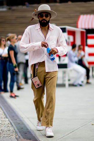 How to wear: grey wool hat, white low top sneakers, khaki dress pants, pink long sleeve shirt