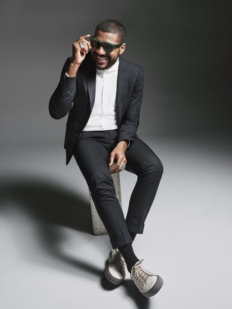 How to wear: dark green sunglasses, grey leather low top sneakers, white dress shirt, black suit