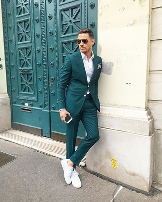 How to wear: light blue pocket square, white leather low top sneakers, white dress shirt, teal suit