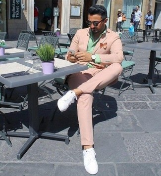 How to wear: dark brown sunglasses, white leather low top sneakers, mint dress shirt, pink suit