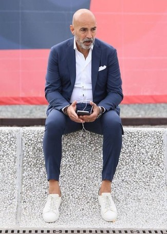 How to wear: white pocket square, white canvas low top sneakers, white dress shirt, navy suit