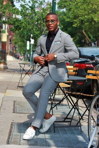 How to wear: light blue pocket square, white leather low top sneakers, black dress shirt, navy gingham suit