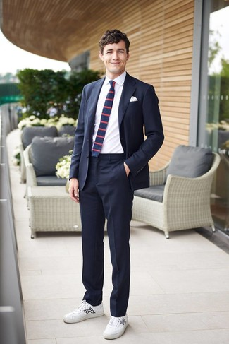 How to wear: navy horizontal striped tie, white leather low top sneakers, white dress shirt, navy suit