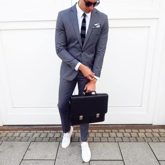 How to wear: black leather briefcase, white low top sneakers, white dress shirt, charcoal suit